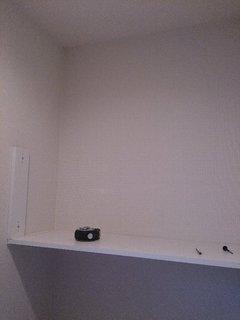 手が届かないトイレの収納棚を扉付きの収納に